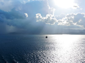 stock photo of messina  - ship comes to Calabria shore in Strait of Messina in summer evening - JPG