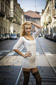 picture of turin  - Pretty Young Blonde Woman in Sexy White Dress in Turin City Center - JPG