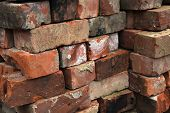picture of reuse  - Pile of old reclaimed bricks cleaned ready for reuse in renovation project - JPG
