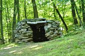 foto of stone house  - prehistoric stone hut house detail into the forest - JPG