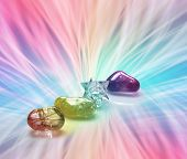 picture of qi  - Four Rainbow Healing Crystals on a vibrant radiating rainbow colored energy formation background with plenty of copy space - JPG