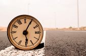 stock photo of time-bomb  - Time Concept Alarm Clock on the Asphalt Street - JPG