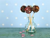 picture of cake pop  - Tasty cake pops on blue background - JPG