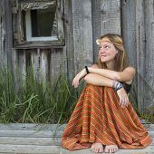 picture of hippy  - Beautiful young hippies girl sitting outdoors in the countryside - JPG