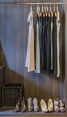 stock photo of wardrobe  - dress and shoes in wooden wardrobe at home - JPG