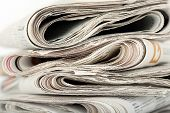 stock photo of brainwashing  - stack of folded newspapers closeup for backgrounds - JPG