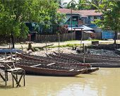 stock photo of u-boat  - Wooden boats along the riverside in Mrauk U Western Rakhin State Myanmar - JPG