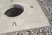 foto of orifice  - Manhole without cover in new concrete block - JPG