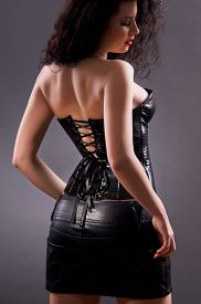 foto of fetish clothes  - Slim sexy woman with hourglass figure in black leather corset - JPG