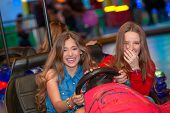 picture of carnival ride  - kids or teens on fairground ride dodgem bumper cars    - JPG