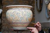picture of paint pot  - View of a ceramic pot from Caltagirone being decorated by a local artisan - JPG