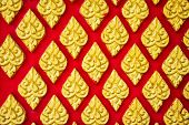 picture of mural  - traditional Thai style art gold mural pattern on the red wall - JPG