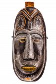 foto of cultural artifacts  - an ancient african wooden mask isolated over a white background - JPG