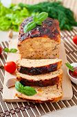 picture of meatloaf  - Homemade ground meatloaf with ketchup and basil - JPG