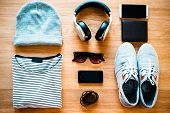 image of no clothes  - Top view of clothing and diverse personal accessory for teenagers laying on the wooden grain - JPG