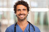 image of trustworthiness  - Portrait of a smiling doctor - JPG