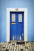 pic of wooden door  - Blue wooden door in the facade of a typical Portuguese house - JPG