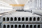 foto of reinforcing  - Stack of precast reinforced concrete slabs in a house - JPG