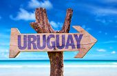 pic of negro  - Uruguay wooden sign with beach background - JPG