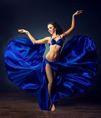 picture of belly-dance  - Beautiful girl with great body dances the dance of the belly  in blue shiny costume - JPG