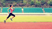 foto of sprinter  - young fitness woman runner running on track - JPG
