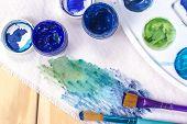 image of bristle brush  - Brush with blue paint - JPG