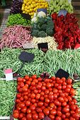foto of stall  - Large market stall with piles of fresh organic vegetables - JPG