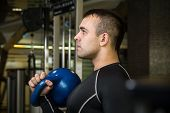 picture of kettlebell  - Kettlebell swing workout training man at gym - JPG