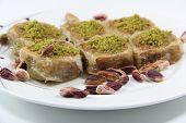 image of baklava  - Turkish dessert baklava isolated on white background - JPG