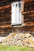 pic of firewood  - firewood stacked by the window - JPG