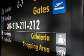 foto of gate  - airport gates information board going on holiday - JPG