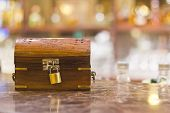 pic of treasure  - treasure box with lock used for tips waiter in restaurant - JPG