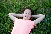 pic of  preteen girls  - Beautiful preteen girl with blue eyes lying on the grass - JPG