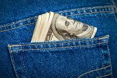 foto of 100 dollars dollar bill american paper money cash stack  - Stack of hundred dollar bills in the back jeans pocket - JPG