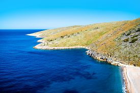 picture of albania  - Beautiful Dhermi beach with rocky mountains on background in Albania - JPG