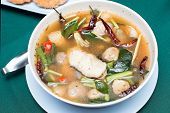 Постер, плакат: Tom Yum Soup thai Style Spicy Soup With Fish
