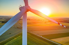 pic of windmills  - Beautiful sunset above the windmills on the field