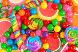 stock photo of lollipops  - Colorful background of assorted candies including gum balls lollipops and jelly candies - JPG