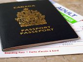 stock photo of passbook  - Canada passport with boarding pass on the table - JPG