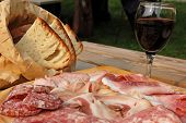 picture of nic  - dish of salami with bread and glass of red wine  - JPG