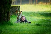 Постер, плакат: Wildlife Photographer Hidden In Grass With Curious Fox On His Back