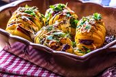 Постер, плакат: Potato Roasts potatoes Home cooking roasts potatoes Baking pan full of baked potatoes stuffed with