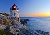 stock photo of atlantic ocean  - Beautiful lighthouse by the ocean at sunset - JPG