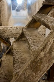 stock photo of crystal salt  - Salt crystals covered wooden structures in the salt mines - JPG