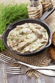 stock photo of liver fry  - Liver stewed in sour cream in a frying pan - JPG