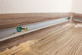 stock photo of plinth  - install new baseboards - JPG
