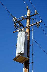 stock photo of transformer  - A wooden pole and crossarms support a step - JPG
