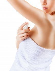 image of deo  - Close up of woman applying deodorant on underarm isolated on a white background - JPG