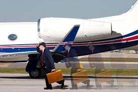 picture of running-late  - Man late for his flight running on runway - JPG