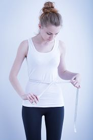 pic of bulimic  - Photo of a skinny girl measuring waist - JPG